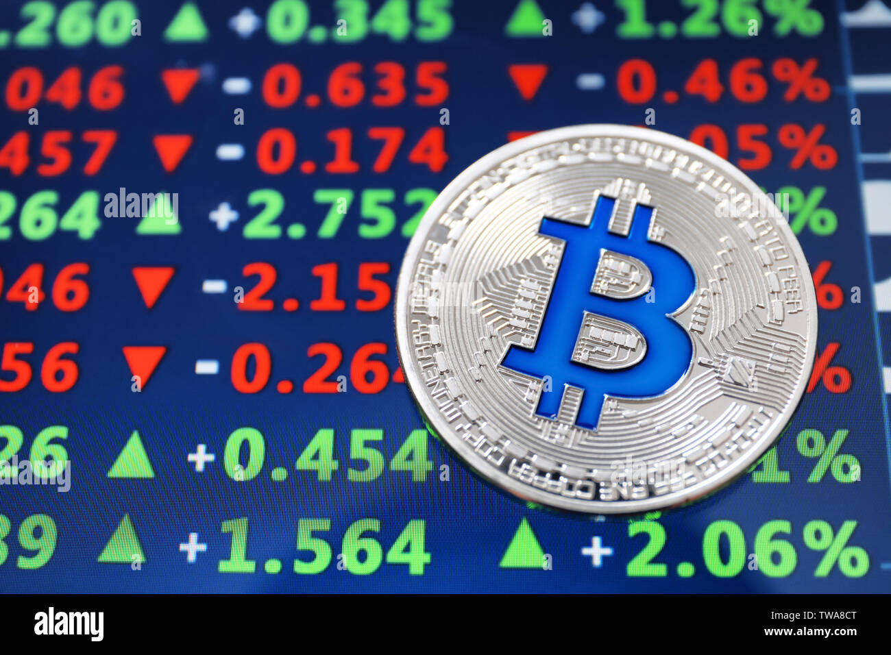 Silver bitcoin on screen with exchange rates. Finance trading - Stock Image