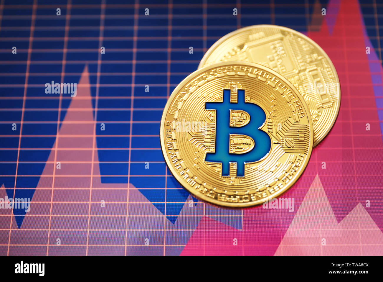 Golden bitcoins on screen with chart. Finance trading - Stock Image