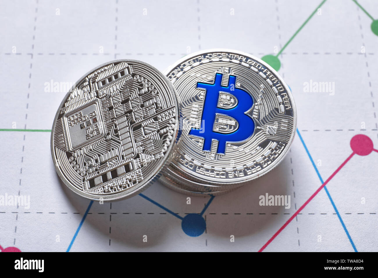 Silver bitcoins on chart. Finance trading - Stock Image