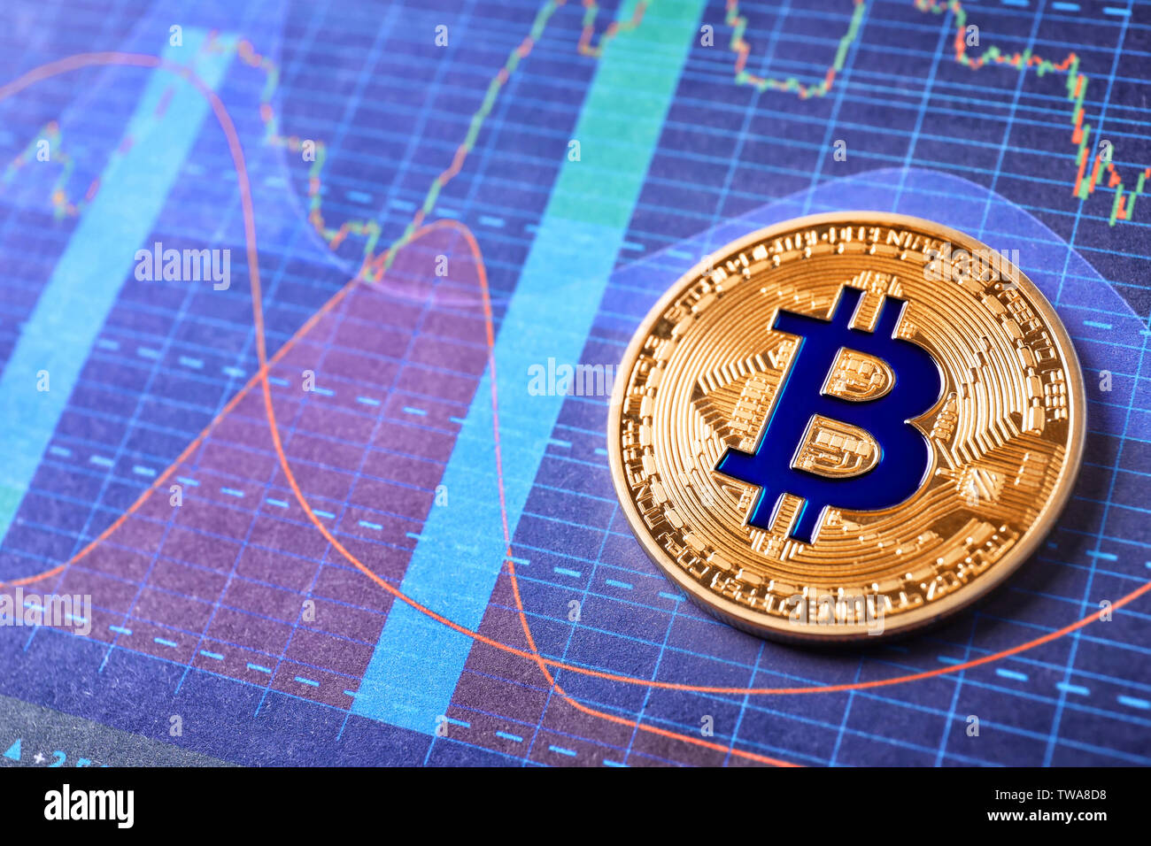 Golden bitcoin on chart. Finance trading - Stock Image