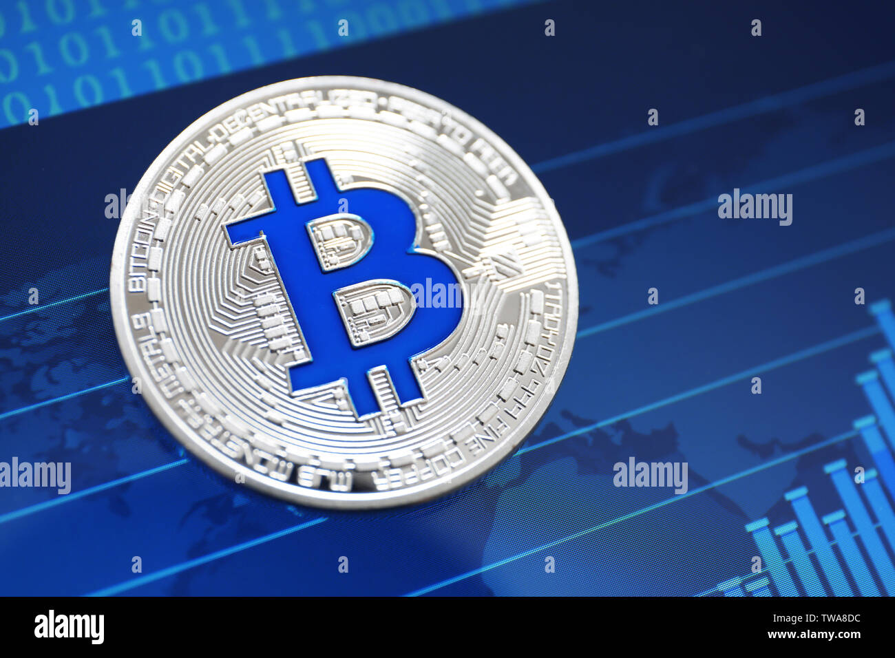 Silver bitcoin on screen with chart. Finance trading - Stock Image
