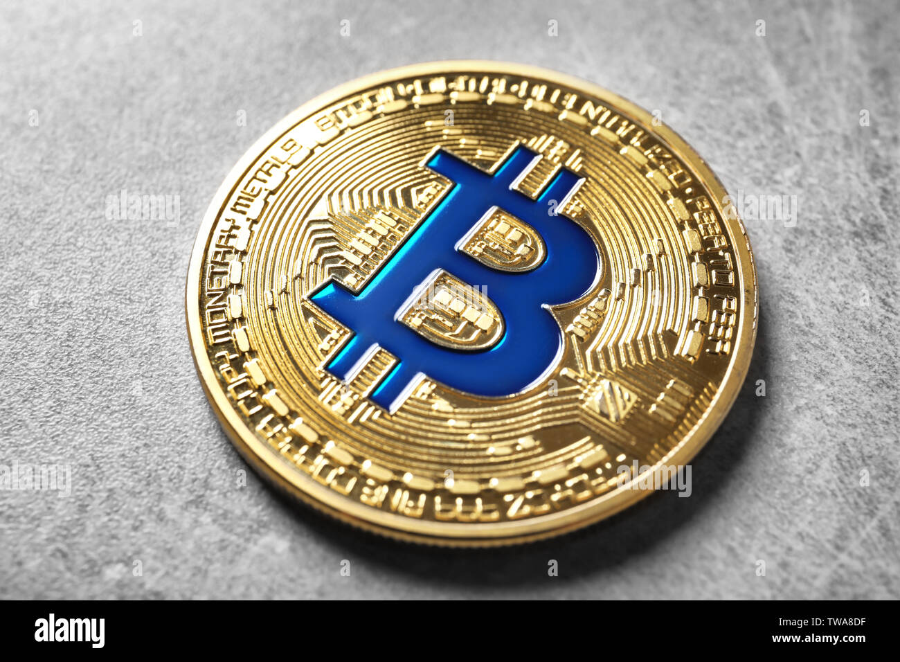 Golden bitcoin on grey background. Finance trading - Stock Image