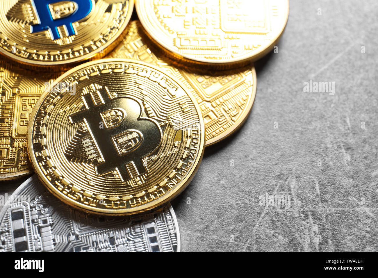 Golden and silver bitcoins on grey background. Finance trading - Stock Image