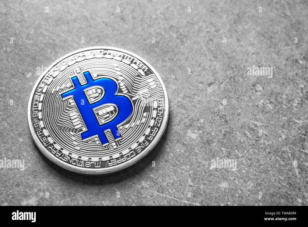 Silver bitcoin on grey background. Finance trading - Stock Image