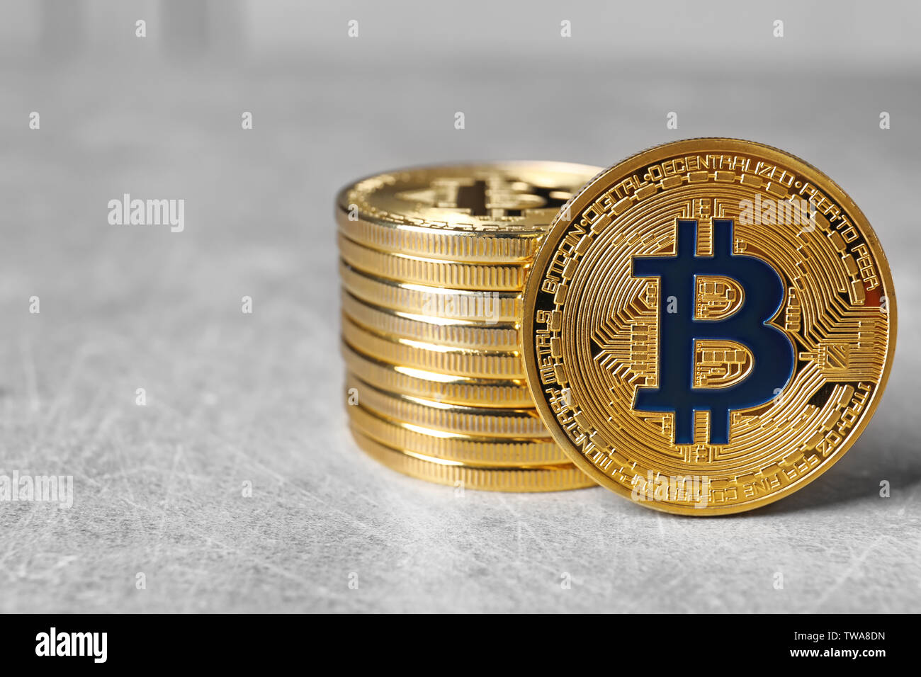 Golden bitcoins on light background. Finance trading - Stock Image