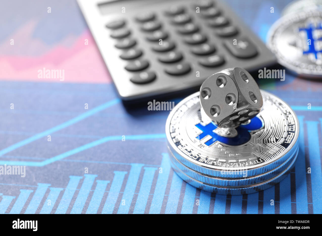 Silver bitcoins, dice and calculator on chart. Finance trading - Stock Image