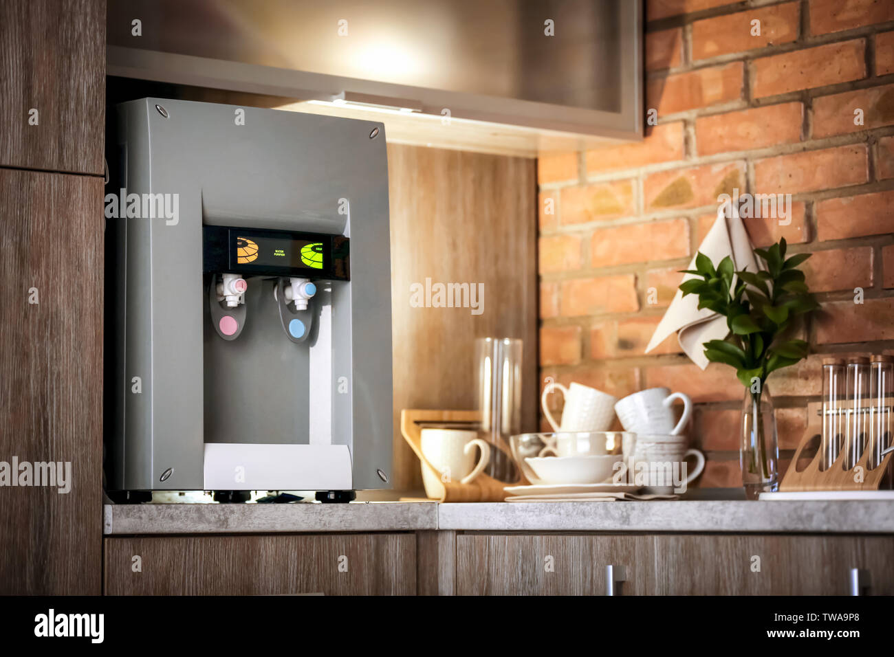 Modern water cooler on kitchen counter - Stock Image
