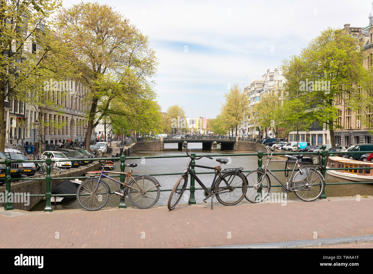 Amsterdam, bicycles chained to bridge railings to prevent theft - Stock Image