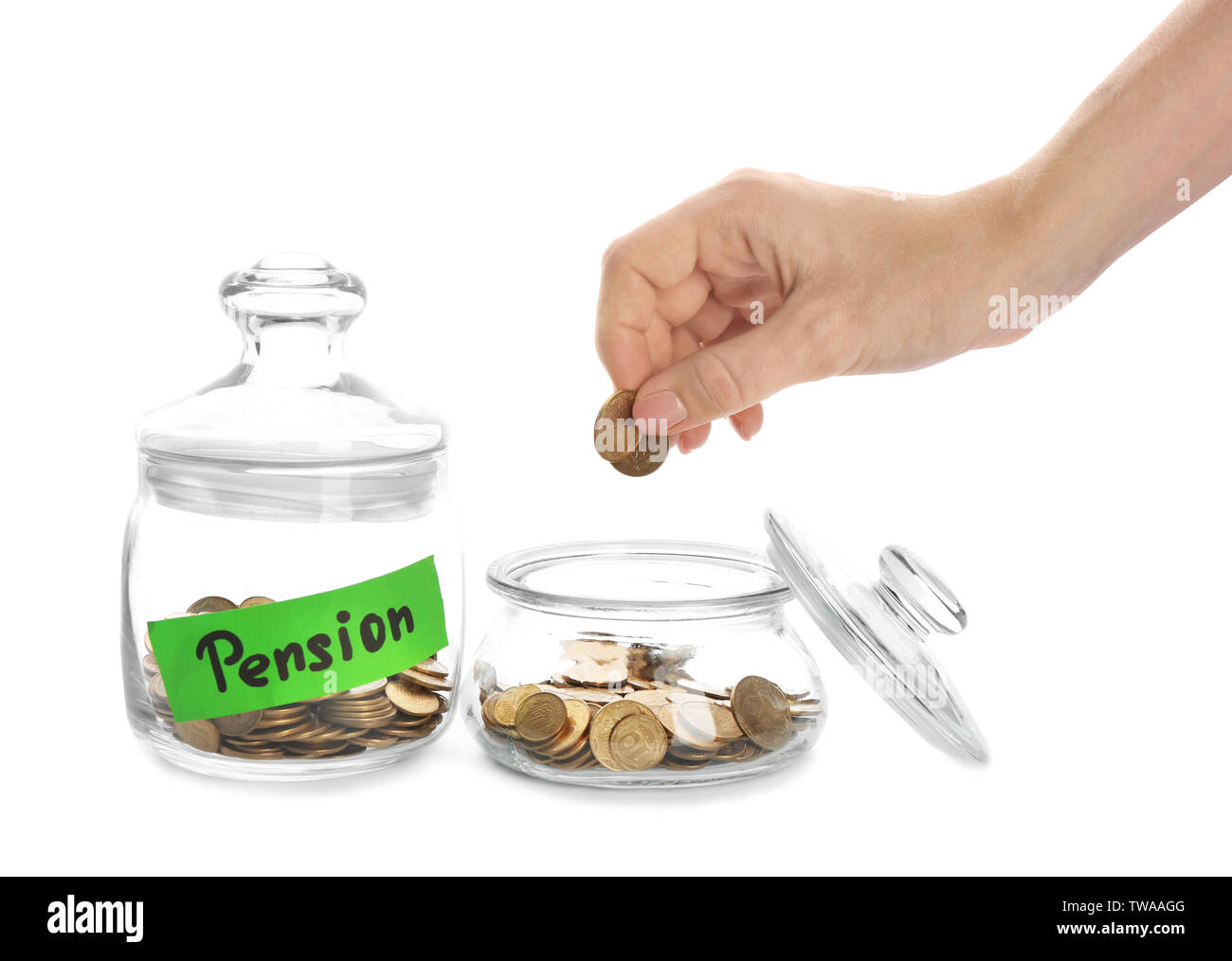 Woman putting coin into glass jar on white background. Pension planning - Stock Image