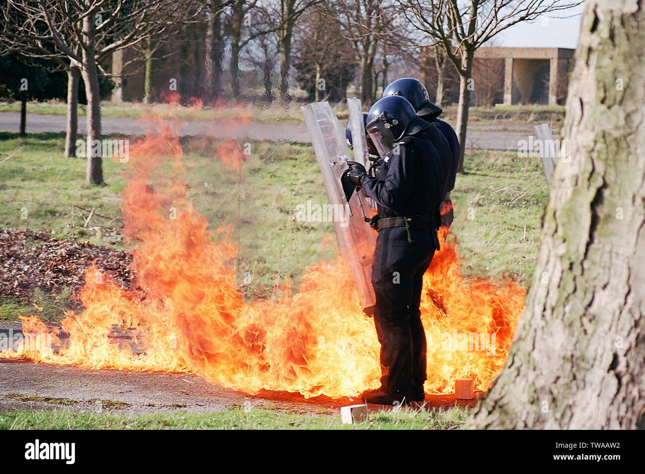 riot police, fire bomb attack - Stock Image