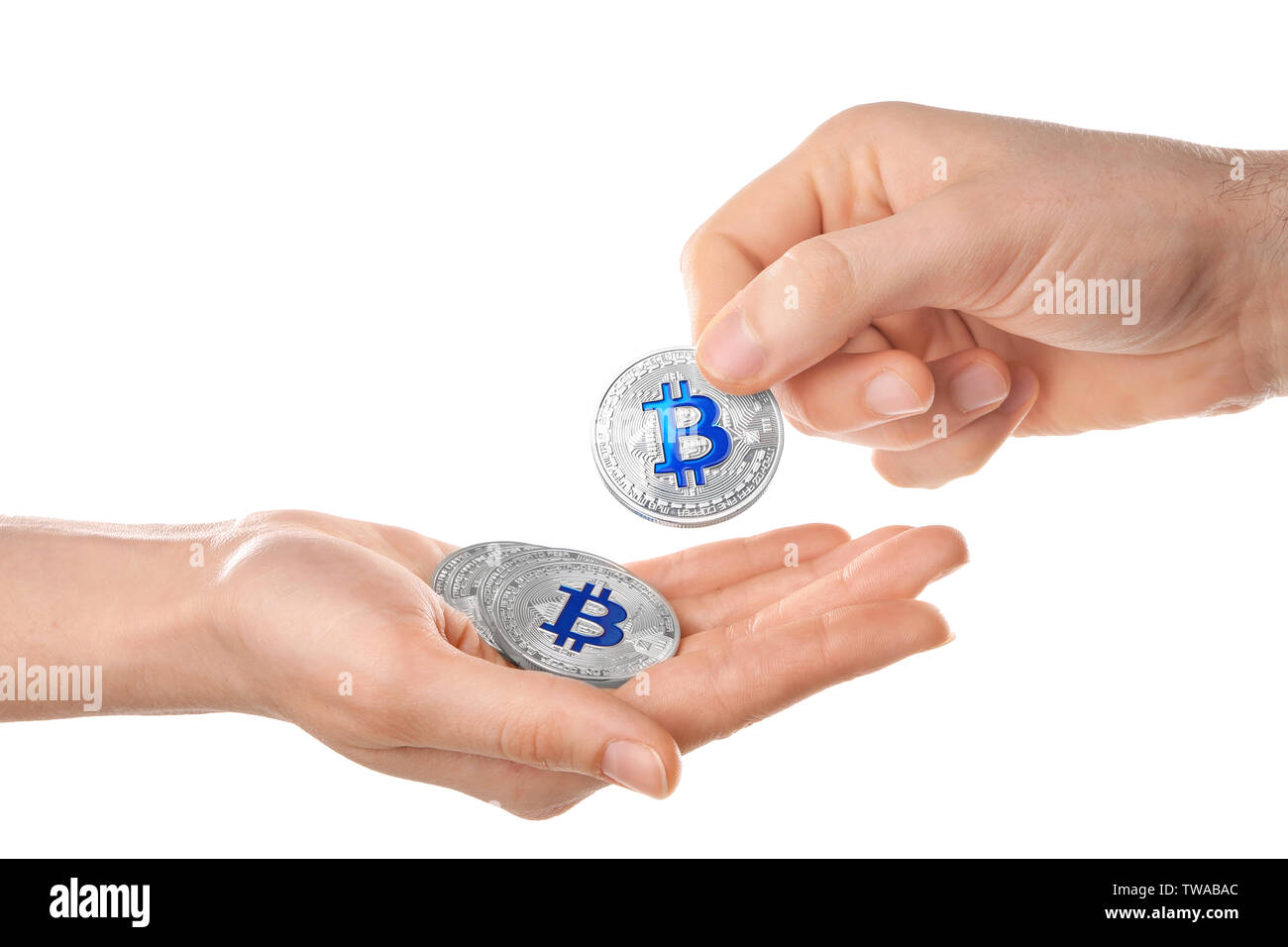 Man giving silver bitcoin to woman on white background - Stock Image