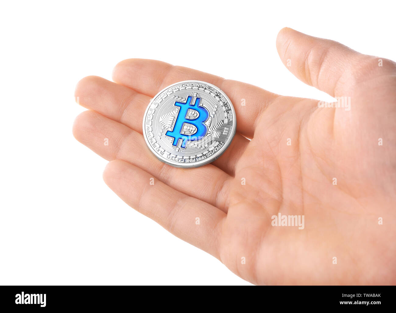 Man holding silver bitcoin on white background - Stock Image