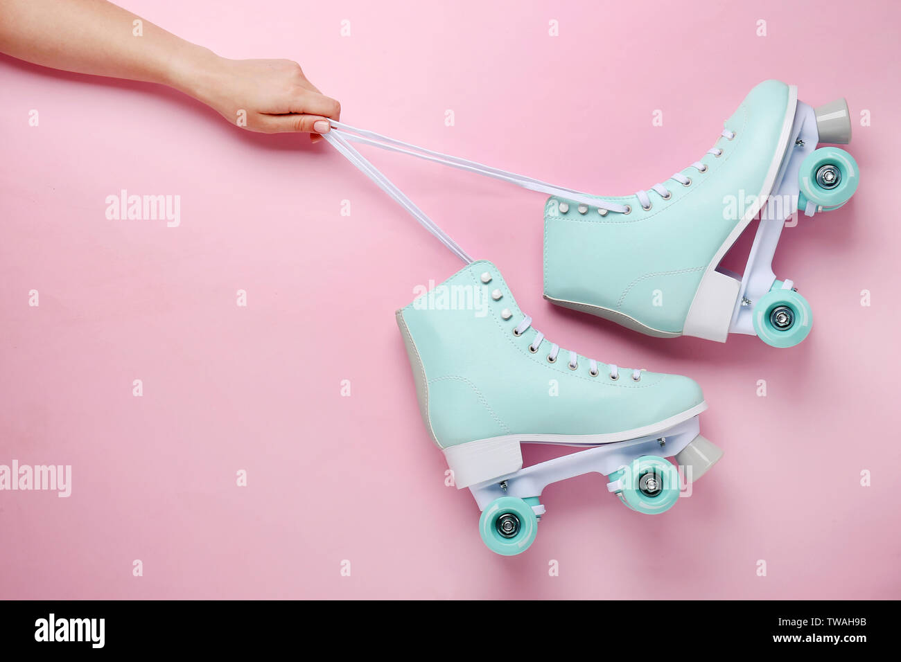 Female Hand And Vintage Roller Skates On Color Background Stock Photo Alamy