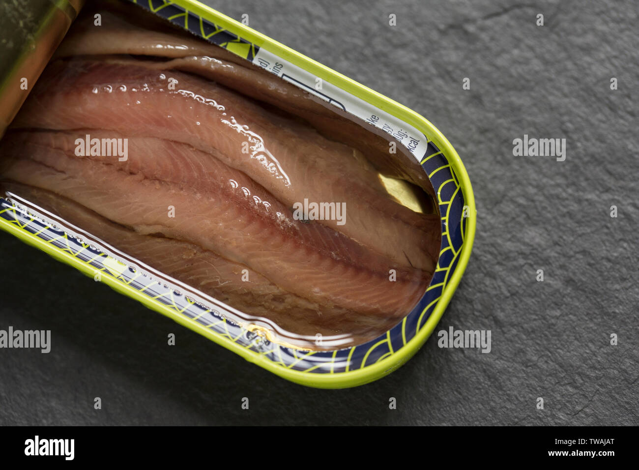 An opened tin of anchovy fillets from anchovies caught in the south east pacific and bought from a supermarket in the UK. Dorset England UK GB - Stock Image