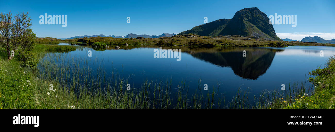 Hoven reflection near Hov, Lofoten Islands, Norway. - Stock Image