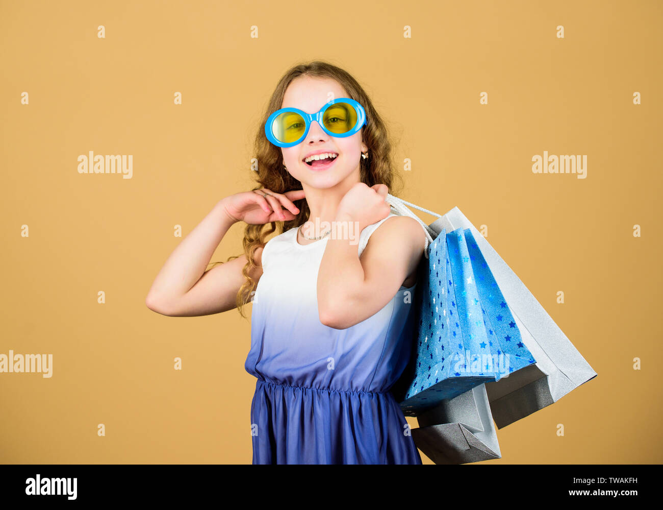 Nice purchase. happy shopping girl with bags. summer sales. Small girl fashion. cyber Monday. Present and gifts buy. black Friday discount. happy birthday holiday. Beauty. Own business. - Stock Image