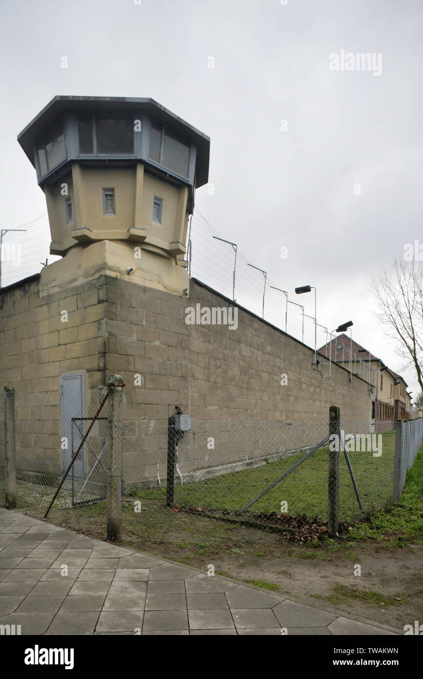 Watchtower and perimeter wall of the Stasi HQ Hohenschonhausen buildings complex, Berlin, Germany. - Stock Image