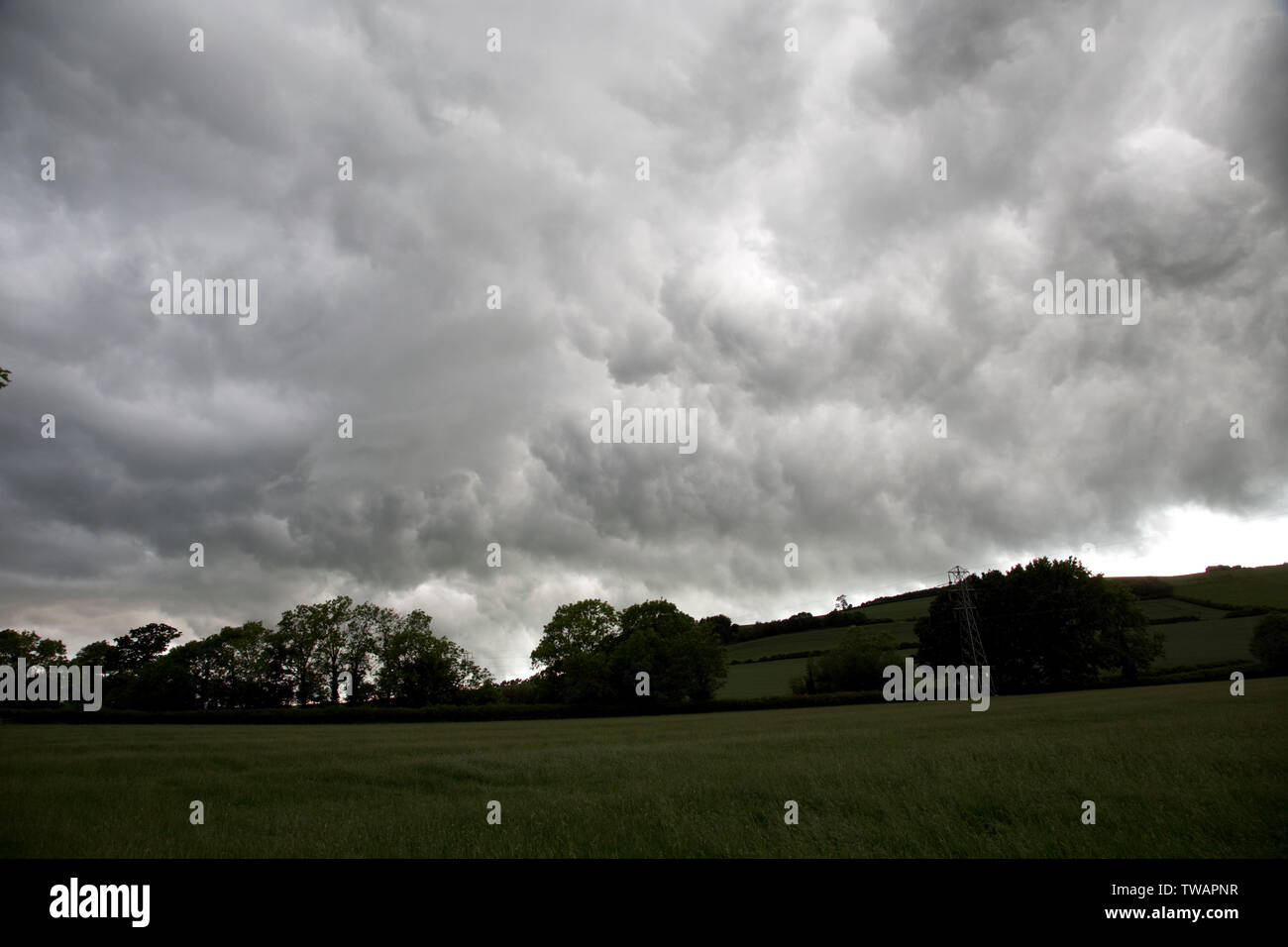 Dark rain clouds from Storm Miguel looming over Meon Hill near Mickleton, Chipping Campden, UK Stock Photo