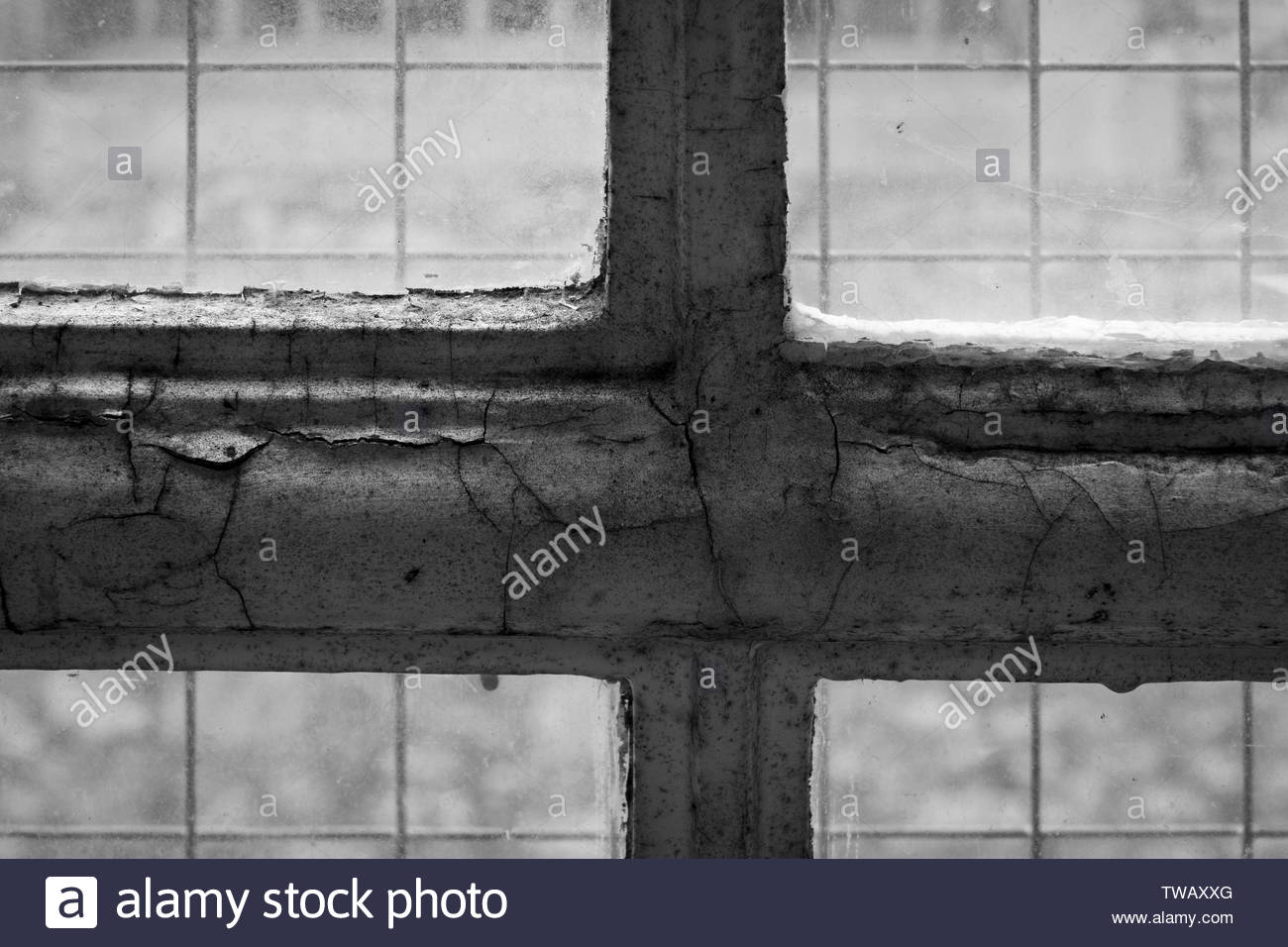 Close up image looking out through a reinforced window of Shepton Mallet Prison, Somerset, England, UK - Stock Image