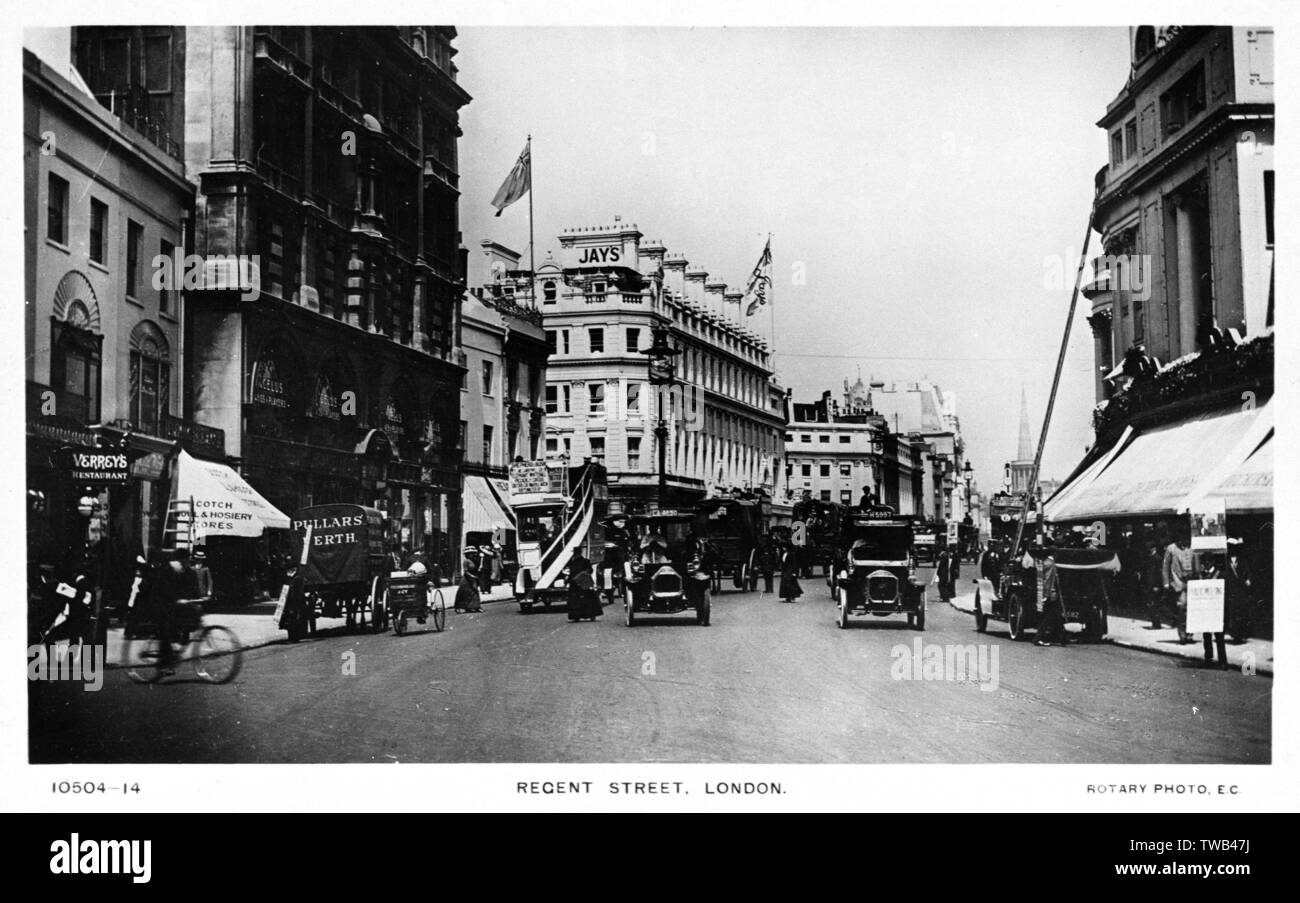 Busy scene in Regent Street, Central London, with Jay's department store on the left and All Souls, Langham Place, in the far distance.      Date: circa 1910 - Stock Image