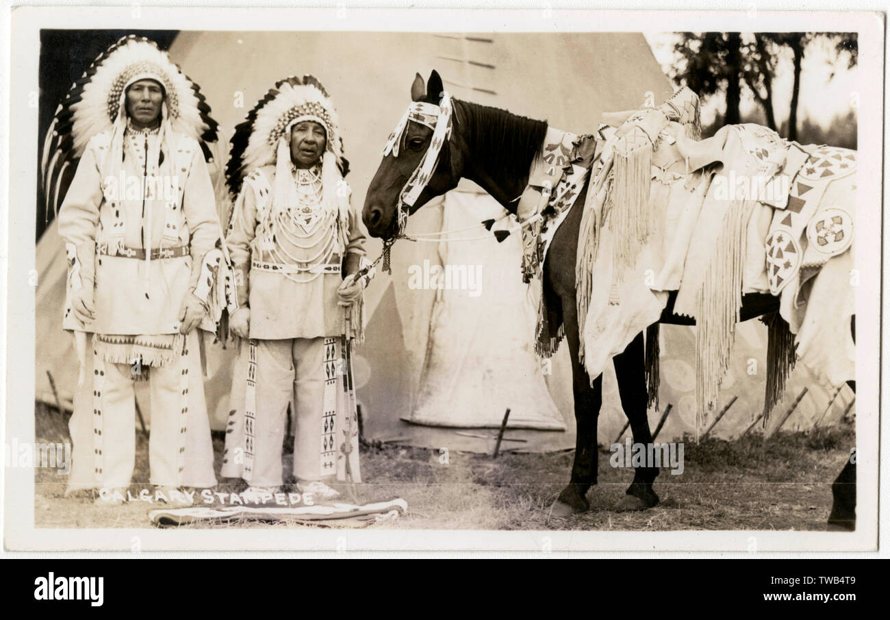 Two Native Indian Chiefs and a warhorse, Calgary Stampede, Canada.      Date: circa 1930s - Stock Image