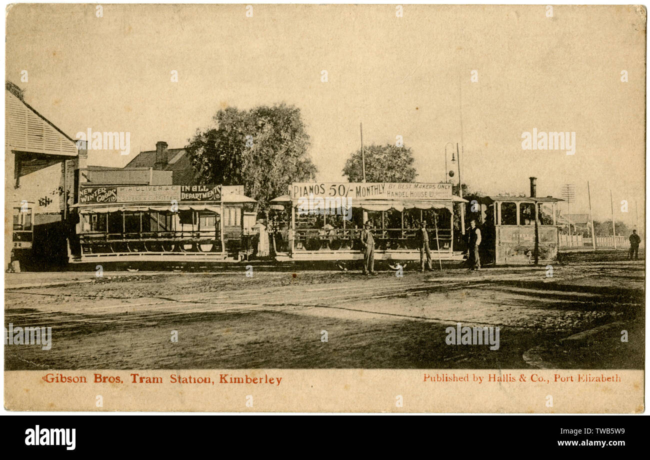 Gibson Brothers Tram Station with double tram drawn by a steam engine, Kimberley, South Africa.      Date: circa 1906 - Stock Image