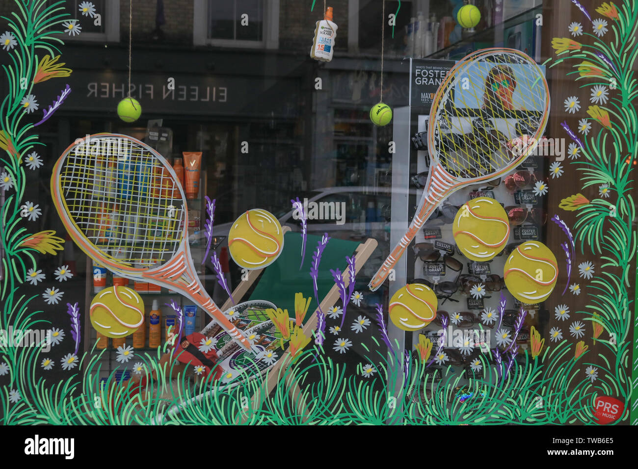 A shop front in Wimbledon High Street   is being decorated with tennis themes as Wimbledon prepares to host the 2019 Wimbledon Tennis Championships. Stock Photo