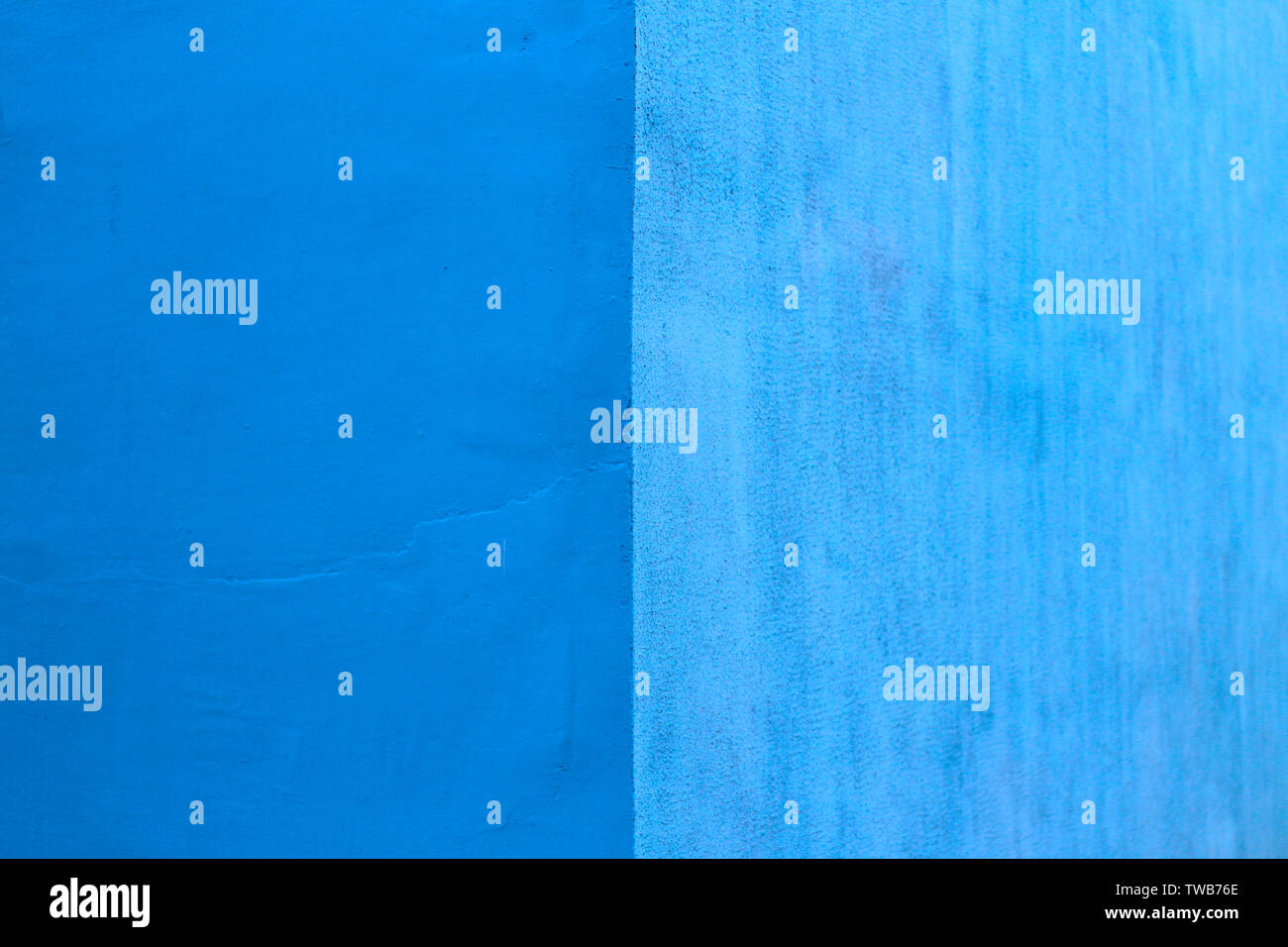abstract image of a wall of two equal shades of blue - Stock Image