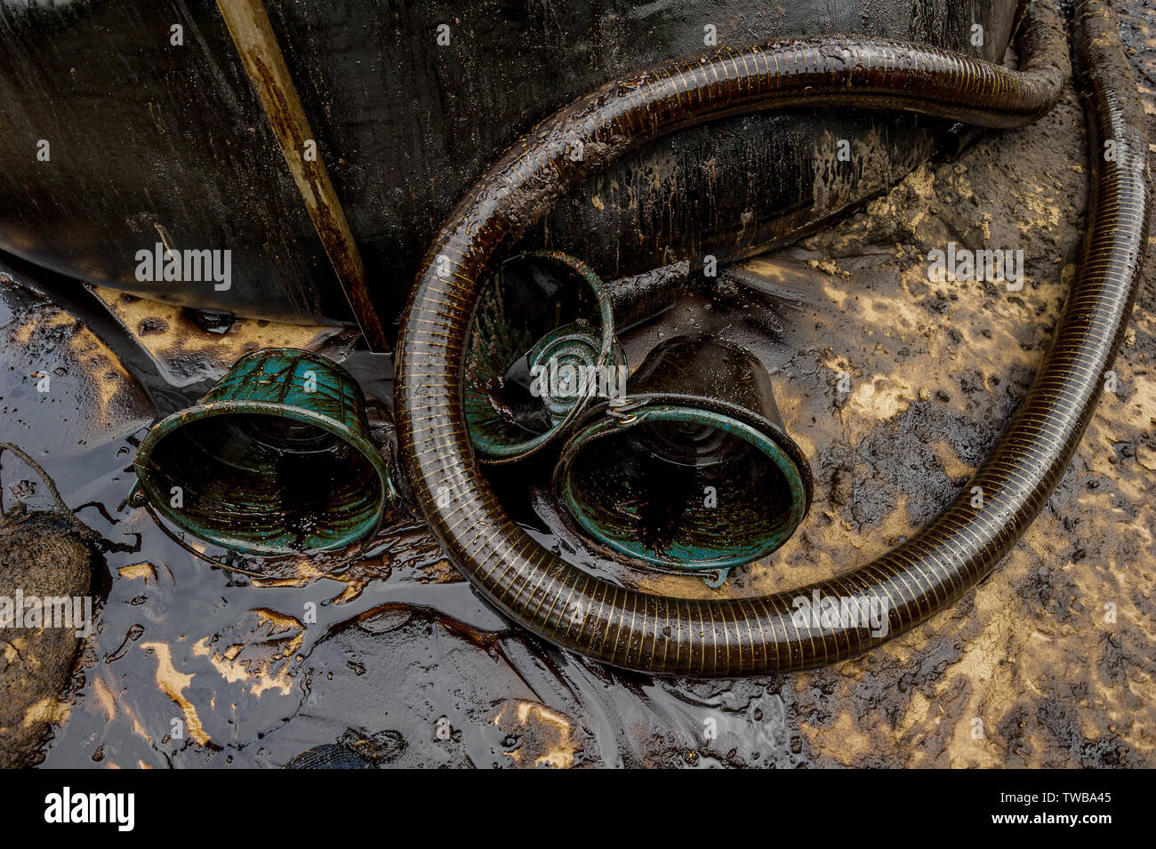 Oil spill diaster - Greasy oil tools and polluting environment at Samet Island, Rayong, Thailand - Stock Image