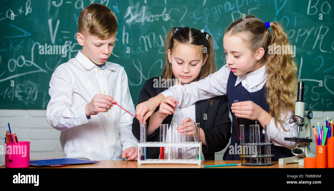 students doing biology experiments with microscope in lab. biology education. Biology equipment. Little kids learning chemistry in lab. Happy children. Biology lesson. Young and confident scientist. - Stock Image