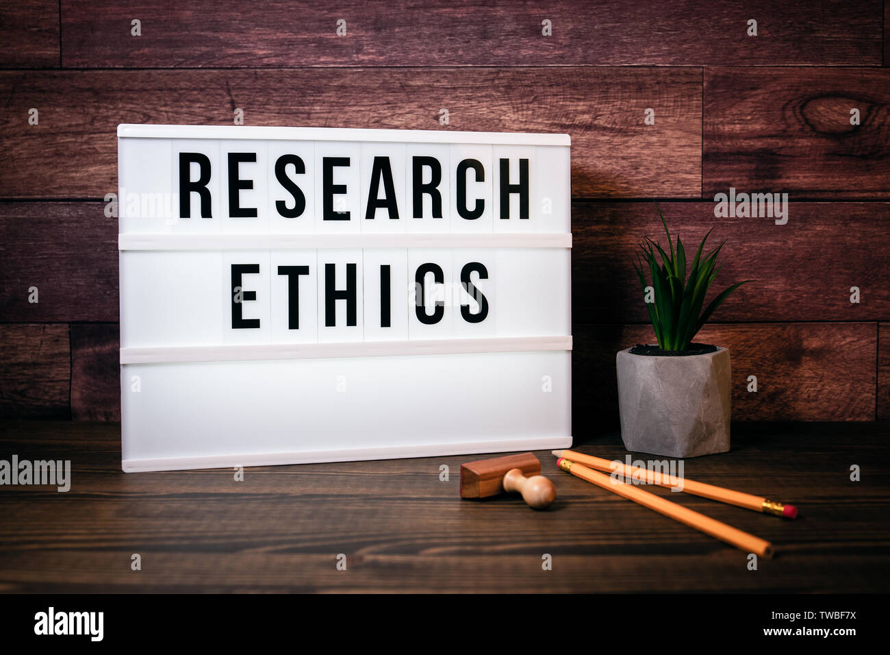 Research Ethics. Text in lightbox - Stock Image