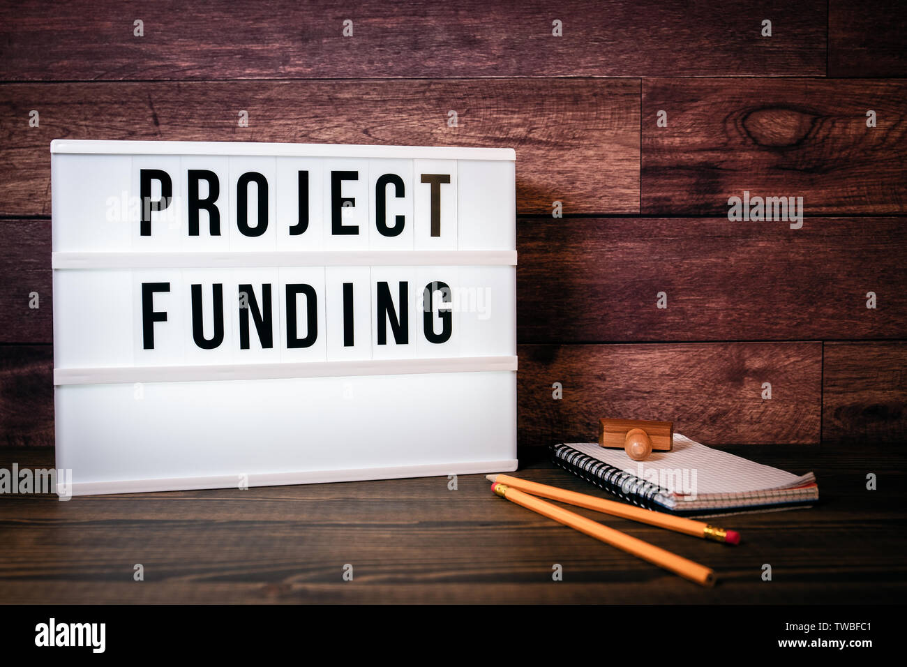 Project Funding. Text in lightbox - Stock Image