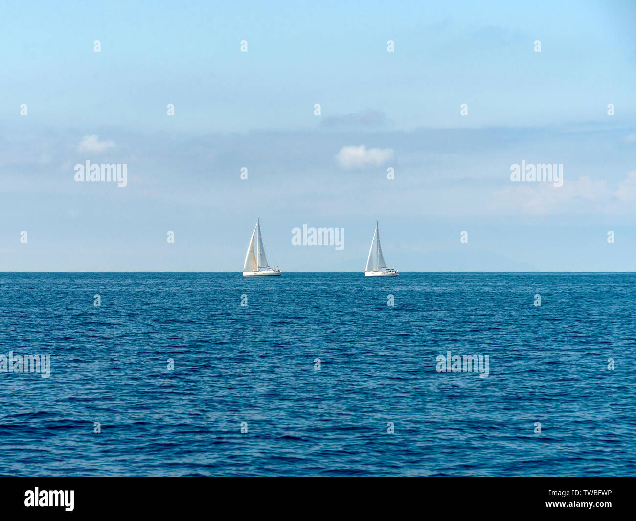 Two sailing yachts on the ocean - Stock Image