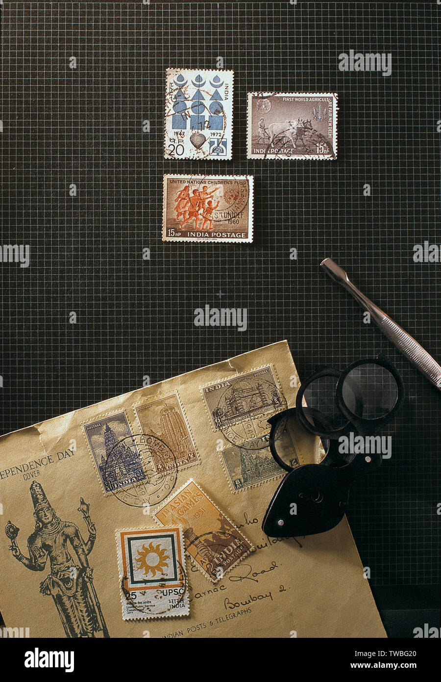 16-Marc-2004-Consept philately postage stamps collectors tools on desk Mumbai maharashtra INDIA - Stock Image