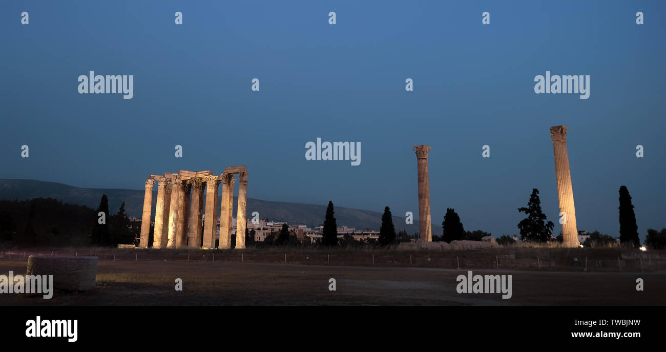 view by night of illuminated Temple of Olympian Zeus in the blue hour in the City of Athens - Greece - Stock Image