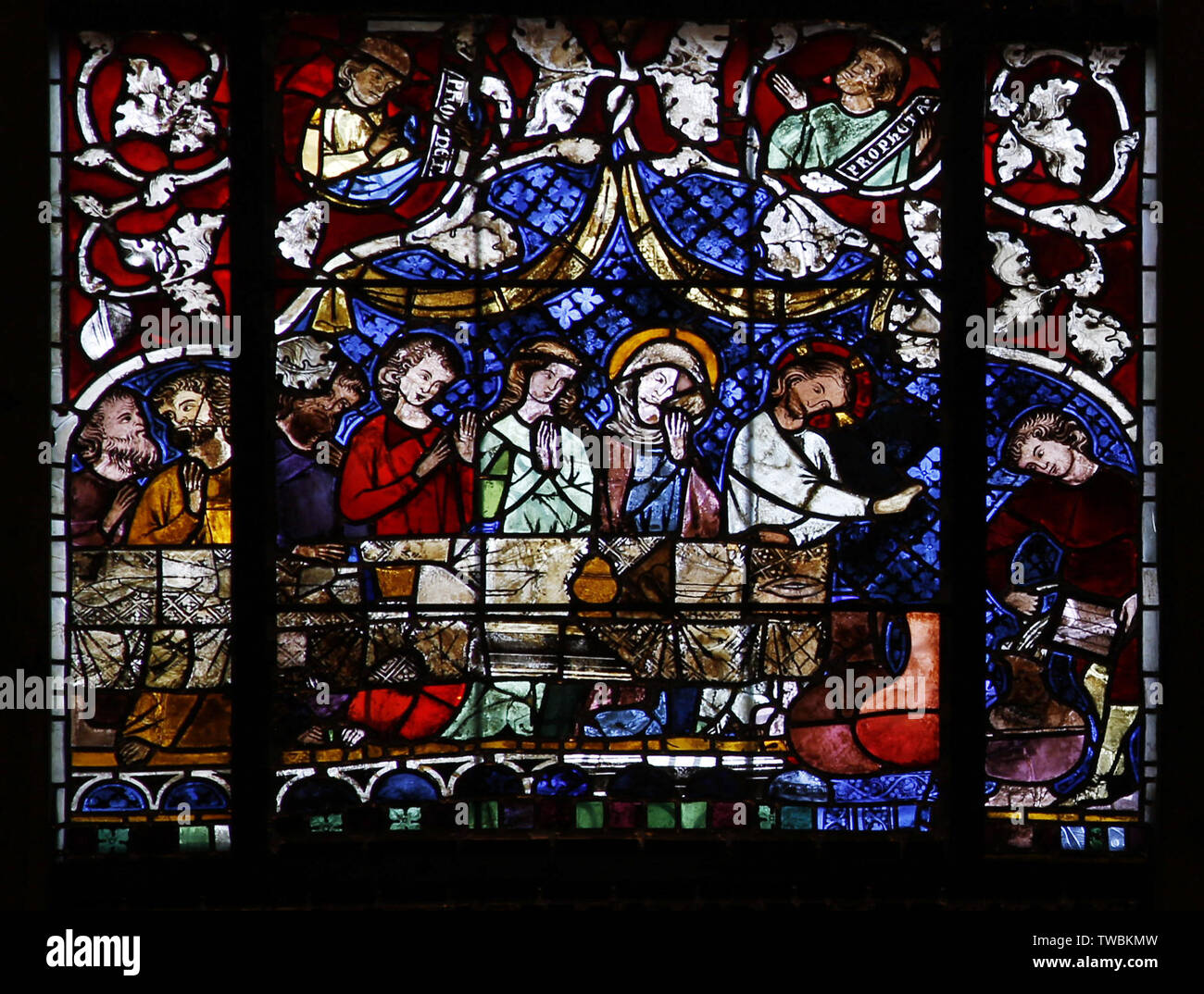 A stained glass window depicting The Wedding in Cana. Jesus turns water into wine, Strasbourg Cathedral of Notre Dame Stock Photo