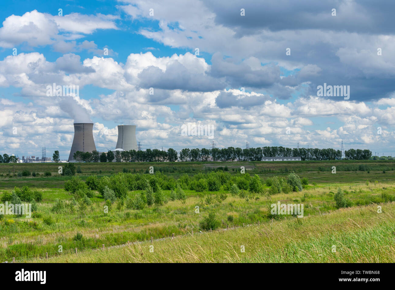 Beautiful landscape with the port of Antwerp and the nuclear power plant of Doel - Stock Image
