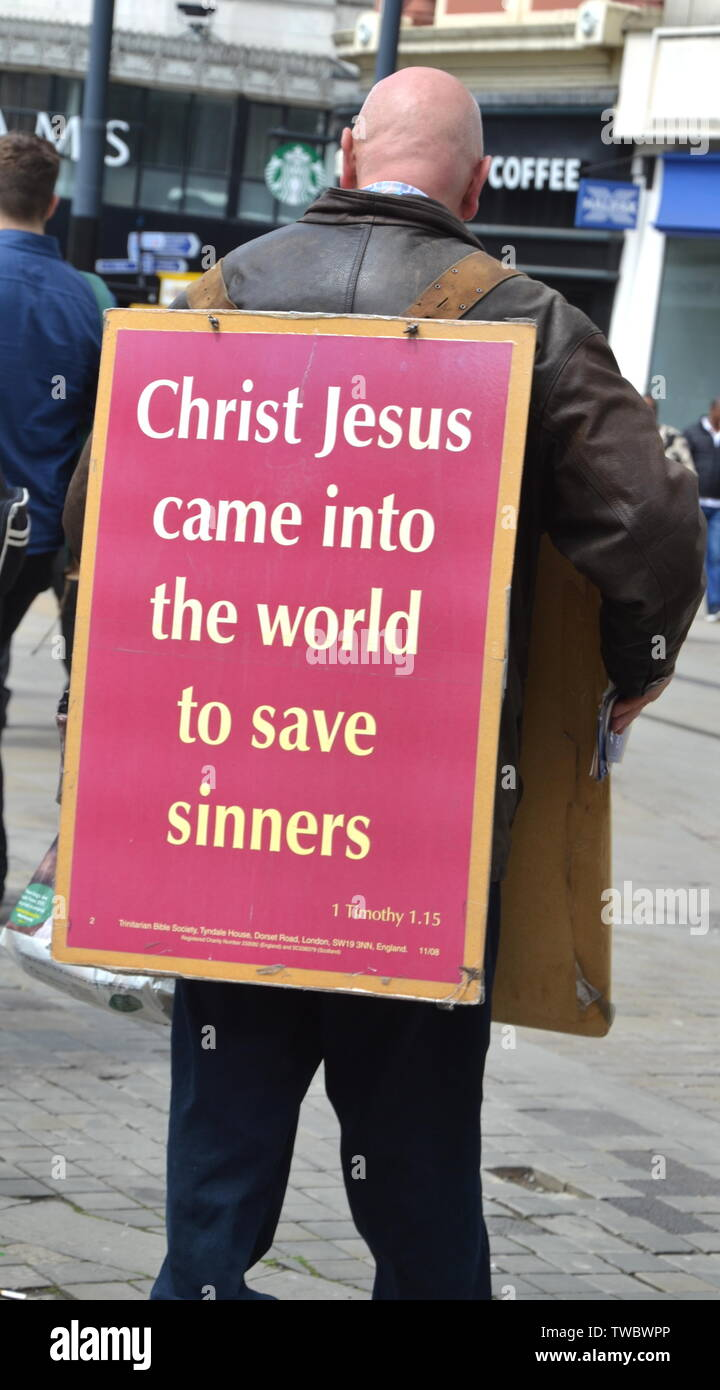 An evangelical Christian wearing a sandwich board in city centre Manchester, uk - Stock Image