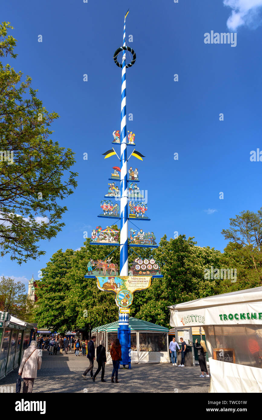 The maypole in the Victuals Market of Munich, Germany, during the day - Stock Image