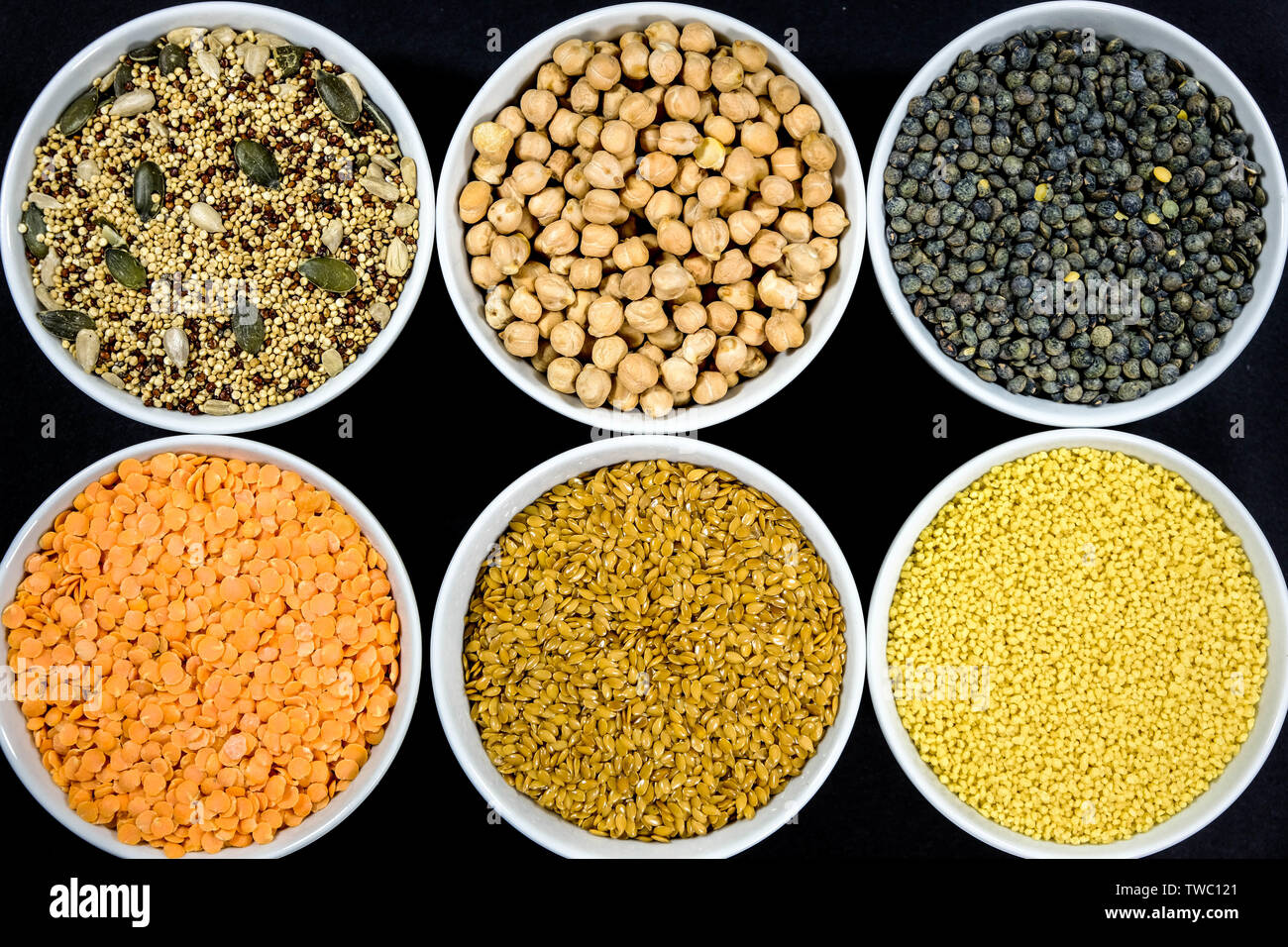 Healthy Selection of Mixed Seeds Sunflower Chia Linseed Couscous Chickpeas Red Green Lentils in White Bowls Stock Photo