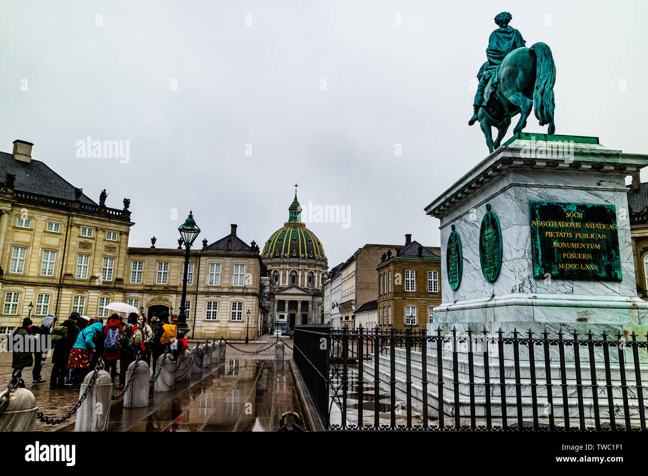 A walking tour group visit Amalienborg Palace, the royal residence in Copenhagen, Denmark. January 2019. Stock Photo