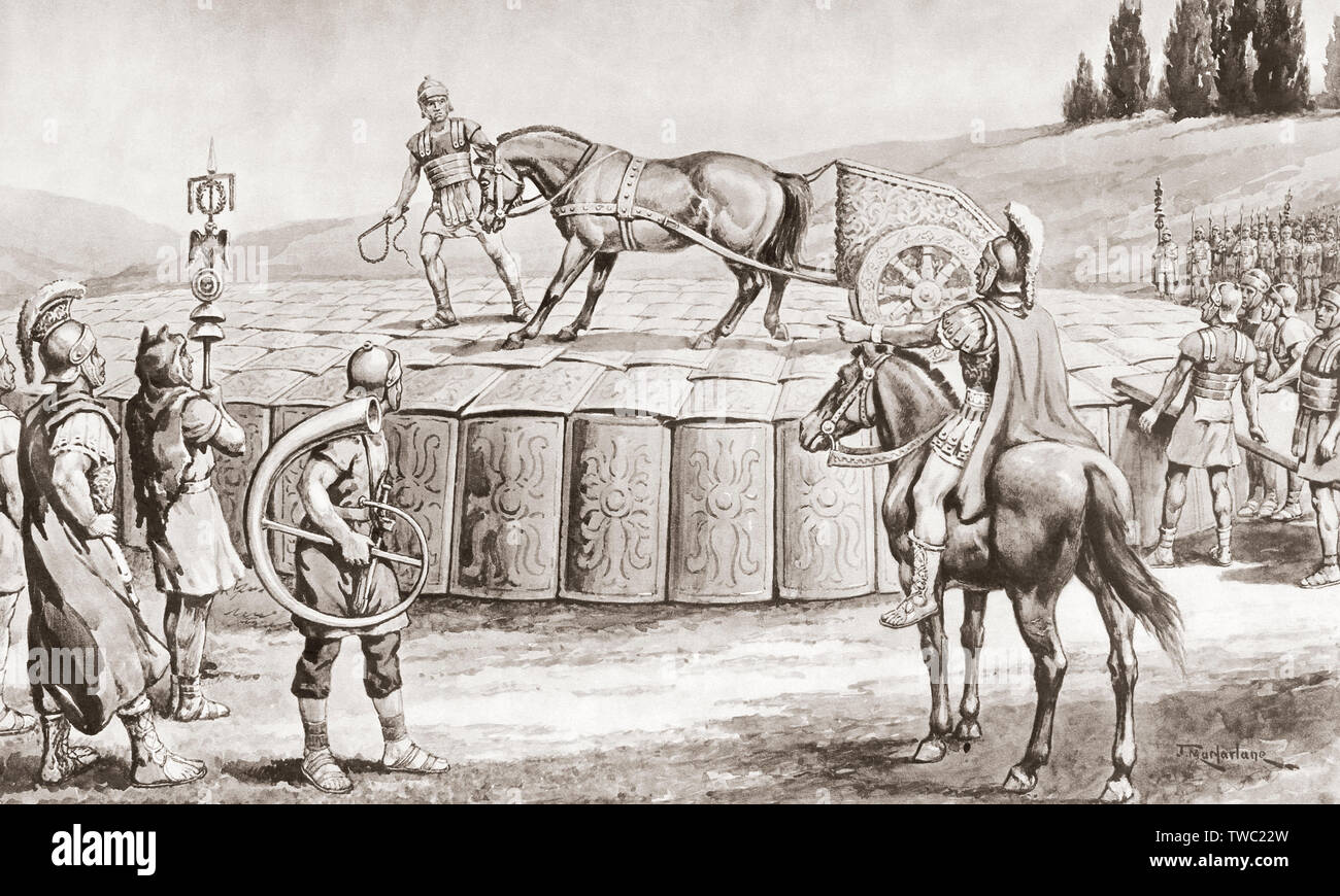 A Roman military exercise in the days of Julius Caesar, testing the Testudo - a military chariot being driven onto the roof of a Testudo or Tortoise formation in order to test its strength. In the testudo formation, the men would align their shields to form a packed formation covered with shields on the front and top.  After a work by J. Macfarlane. From a contemporary print c.1935. - Stock Image