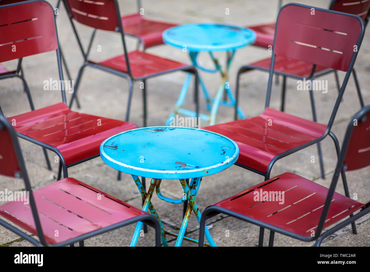 Picture of: Metal Blue And Red Cafe Chairs And Round Tables Stock Photo Alamy