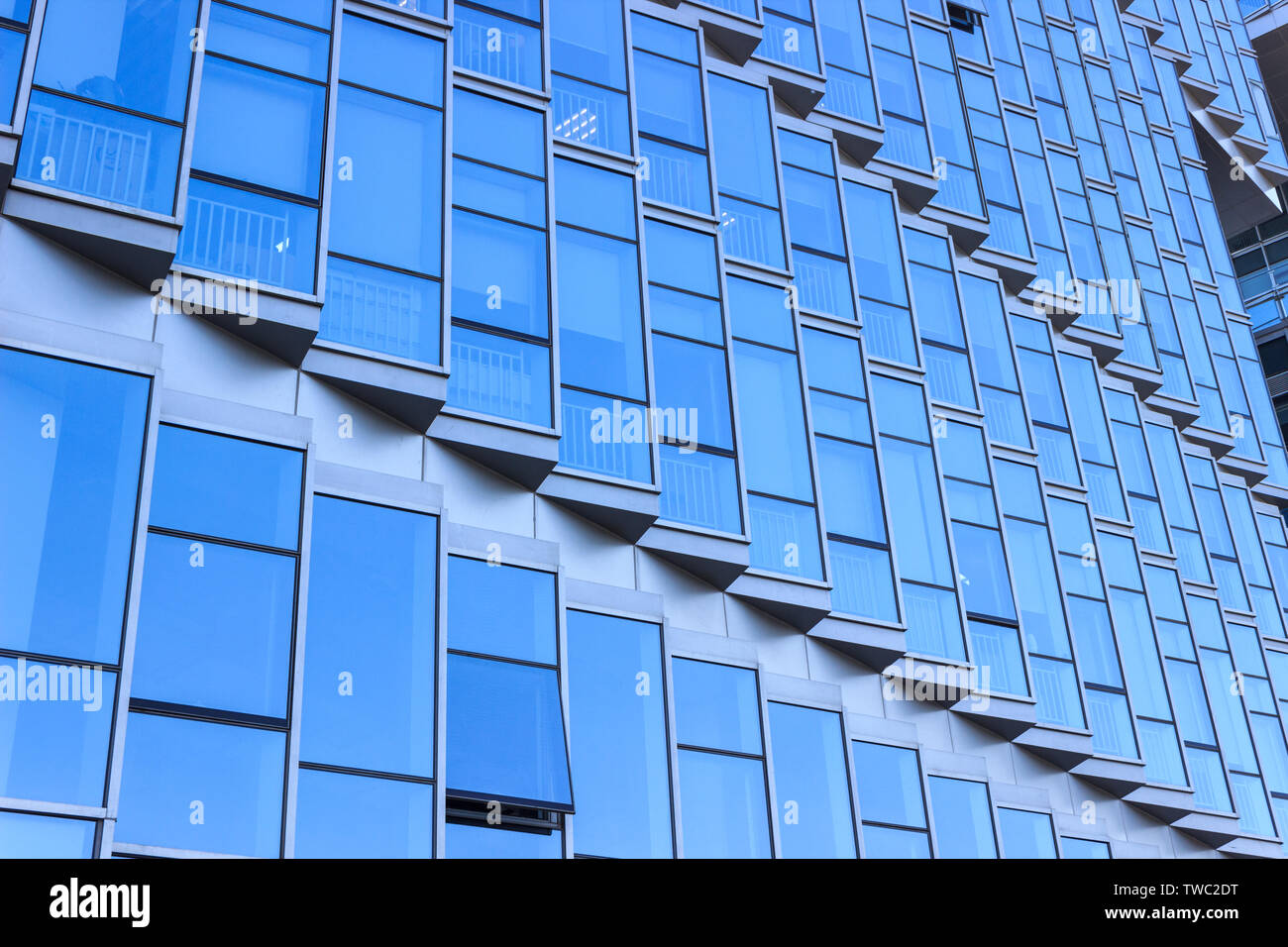 Modern architecture blue glass curtain wall Stock Photo