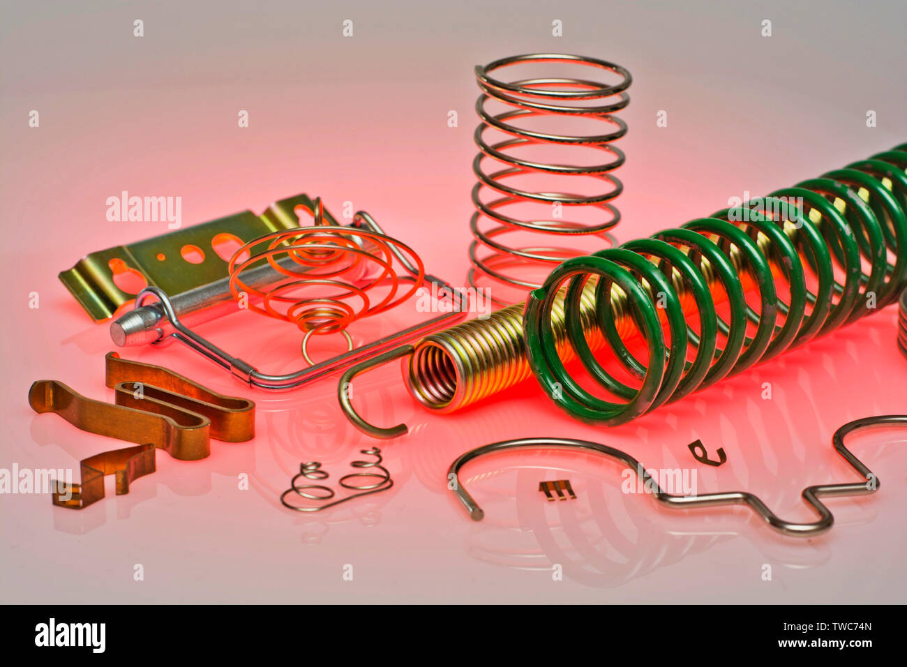 Various types of industrial tension & compression springs & pressings - Stock Image