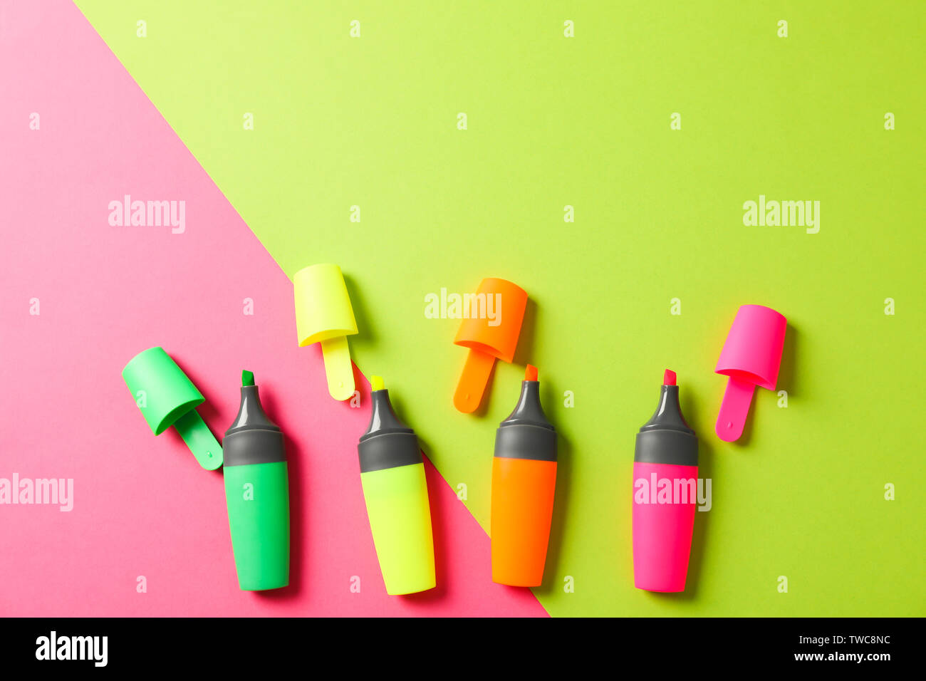 Open highlighters on two tone background, space for text - Stock Image