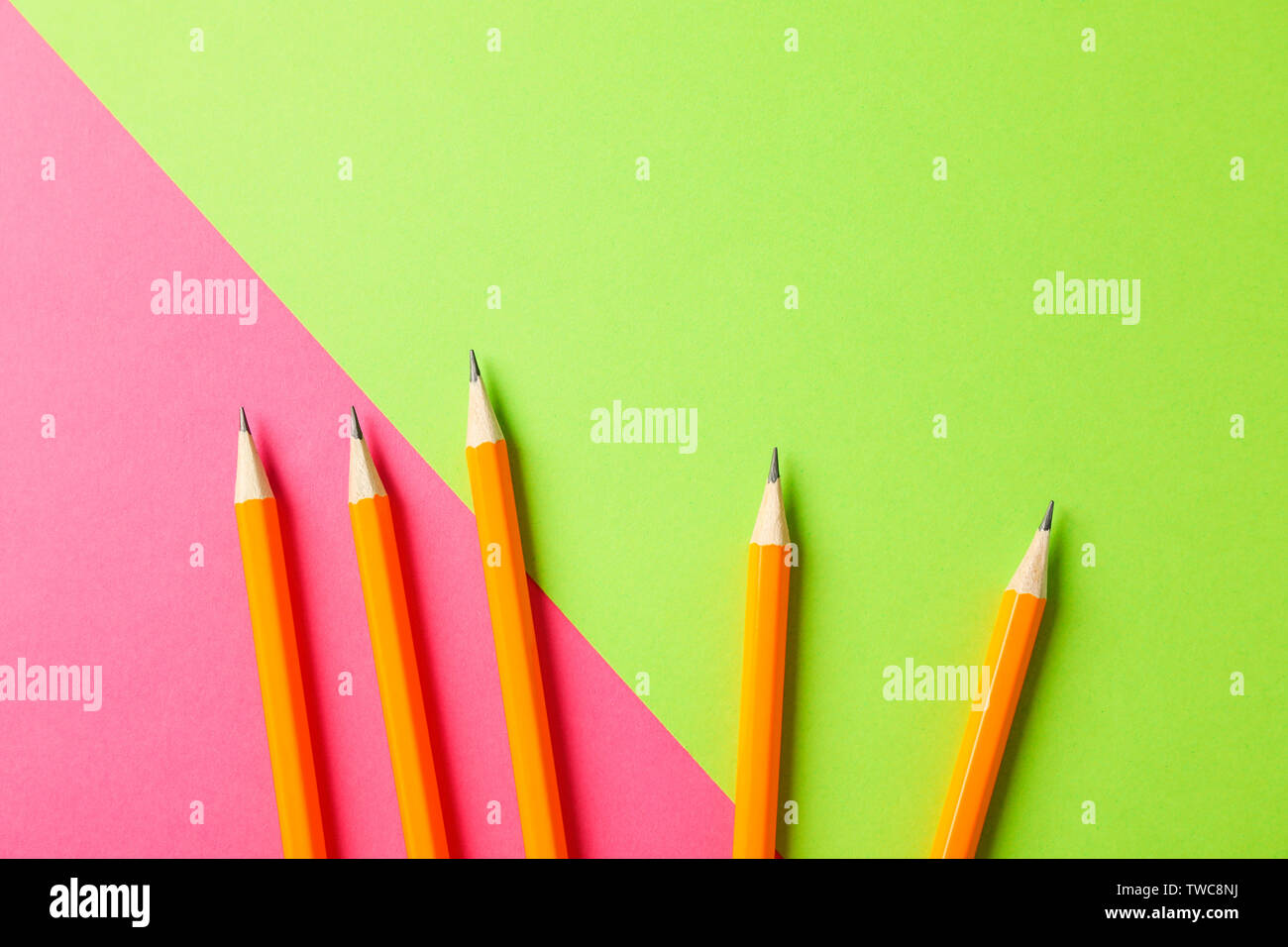 Pencils on two tone background, space for text - Stock Image