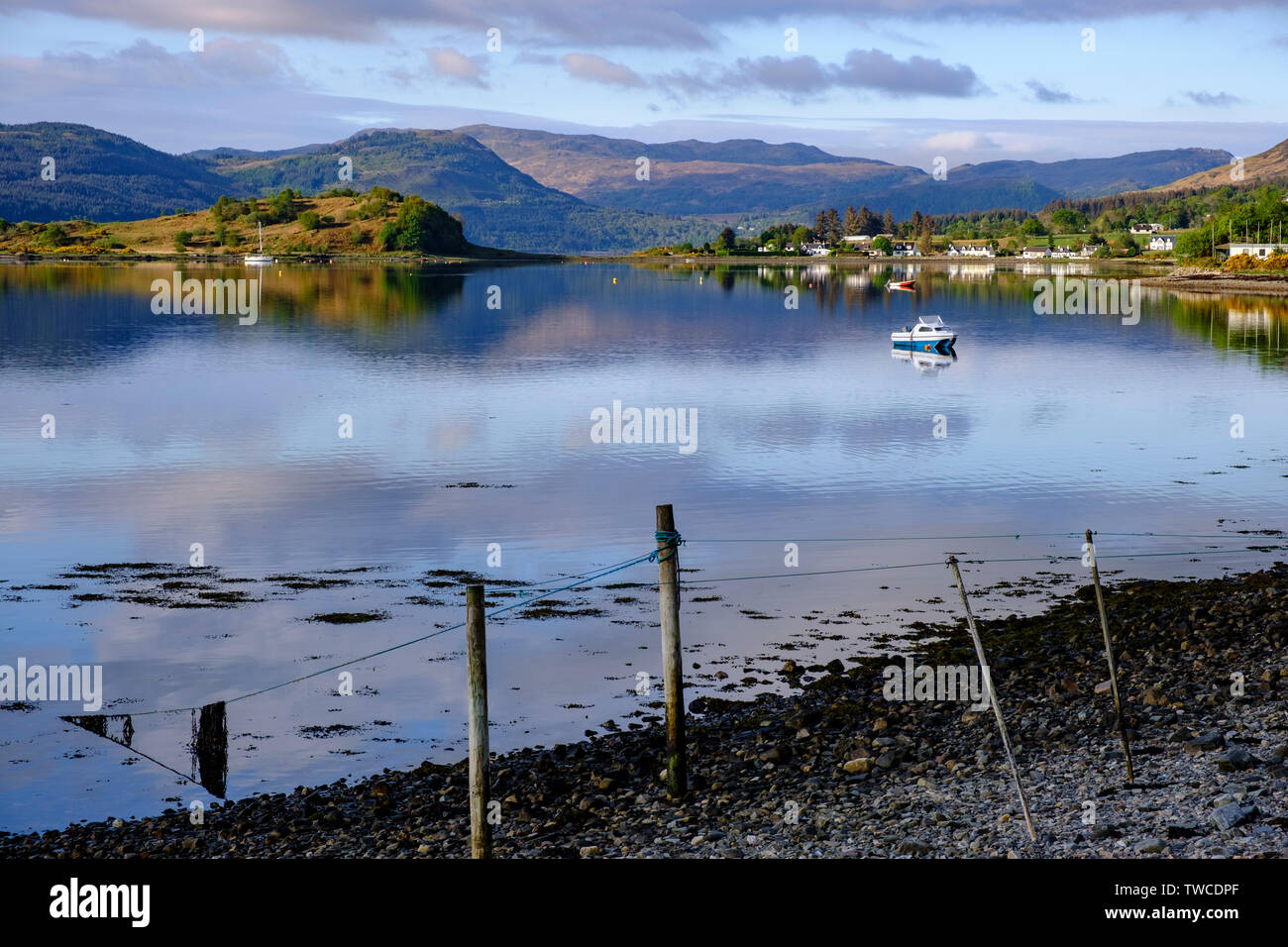 Loch Carron from Lochcarron village on route of North Coast 500. Yachts and boats with Slumbay Island and houses of Dail a'Chladaich. NW Highlands - Stock Image