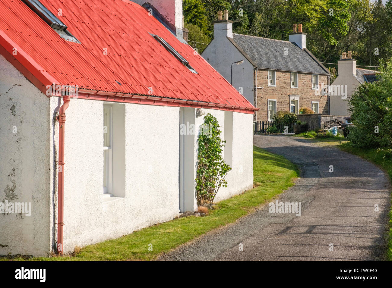 Former Poor House in foreground with former police station beyond in Lochcarron village, Wester Ross, Highlands of Scotland - Stock Image