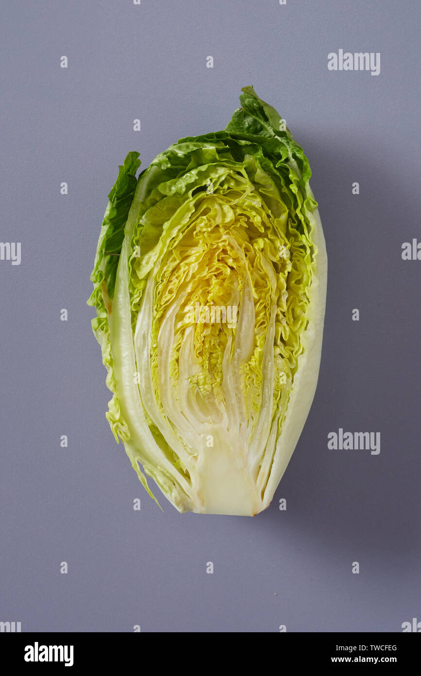 Cross Section Through A Head Of Fresh Chinese Cabbage Or Napa Cabbage Showing The Arrangement Of The Crinkly Green Leaves For Salad Or Cooking Over Gr Stock Photo Alamy